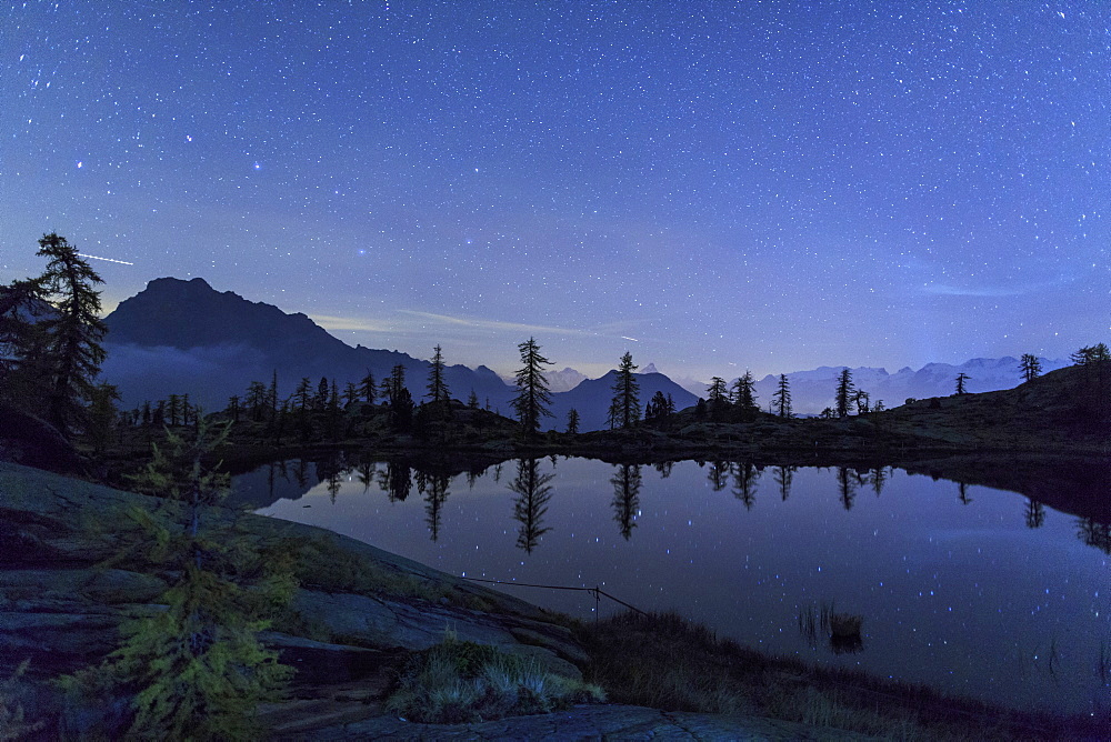 Starry night on Mount Rosa seen from Lake Vallette, Natural Park of Mont Avic, Valle d'Aosta, Graian Alps, Italy, Europe