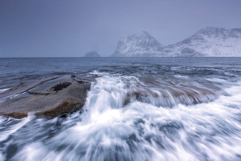 Waves crashing on the rocks of the cold sea, Haukland, Lofoten Islands, Northern Norway, Scandinavia, Arctic, Europe