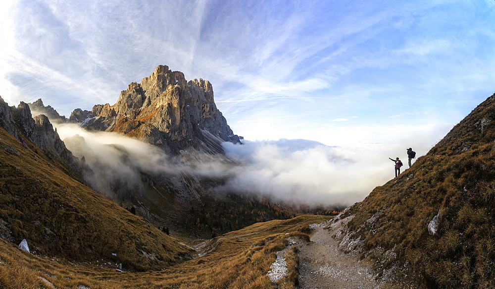 Hikers admire the peaks of Forcella De Furcia at sunrise, Funes Valley, South Tyrol, Dolomites, Italy, Europe - 1179-532