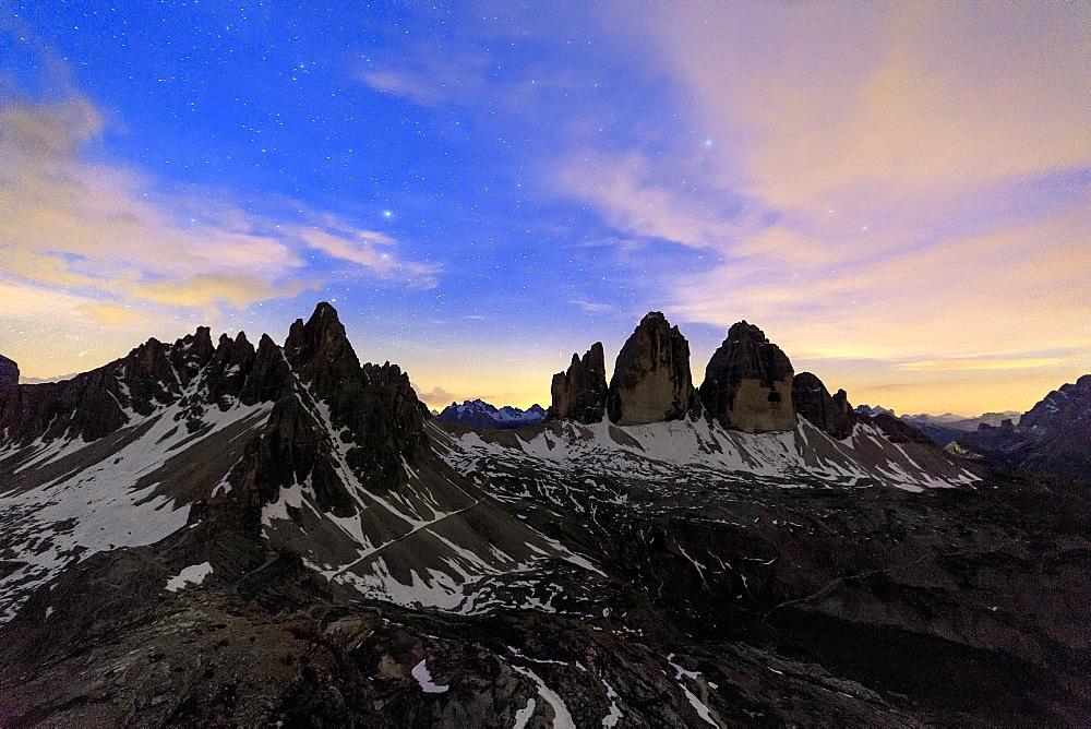 Starry night frame the Three Peaks of Lavaredo, Sesto, Dolomites, Trentino-Alto Adige, Italy, Europe