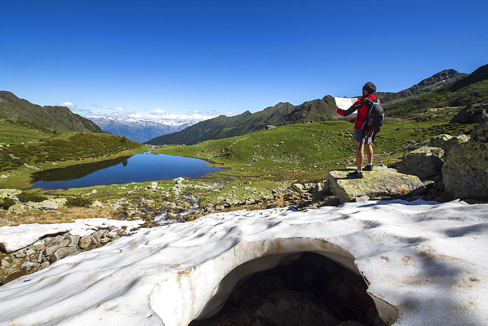 Hiker at Lakes Porcile, Tartano Valley, Orobie Alps, Lombardy, Italy, Europe