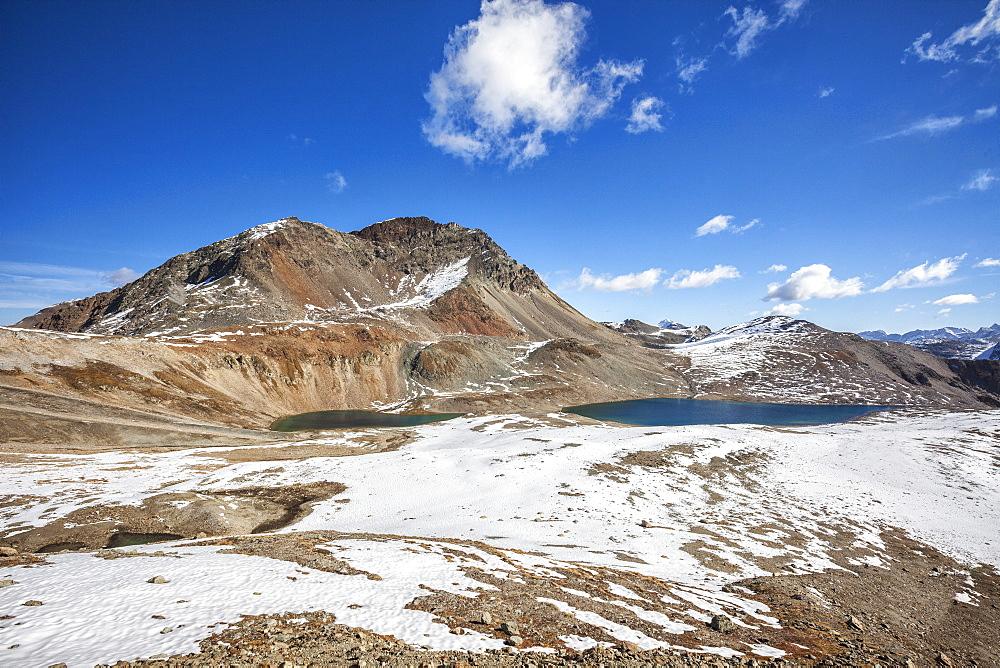 The blue water of Lake Languard, Engadine, Canton of Grisons (Graubunden), Switzerland, Europe