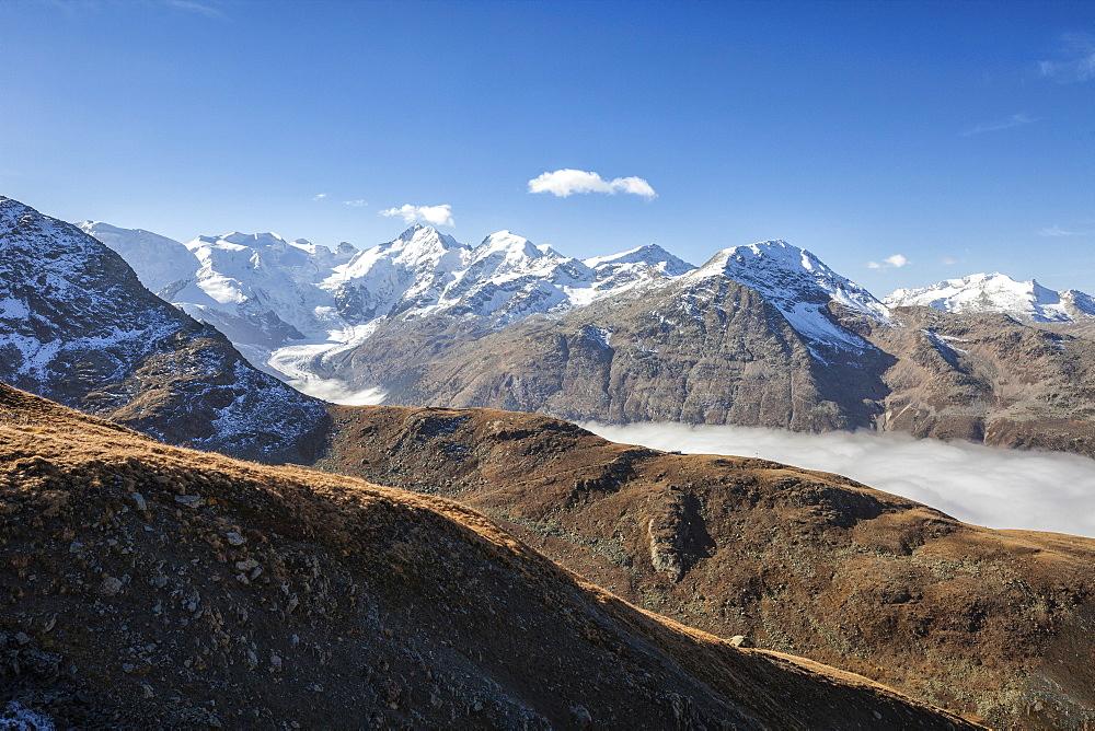 Low clouds toward Bernina Group, Languard Valley, Engadine, Canton of Grisons (Graubunden), Switzerland, Europe