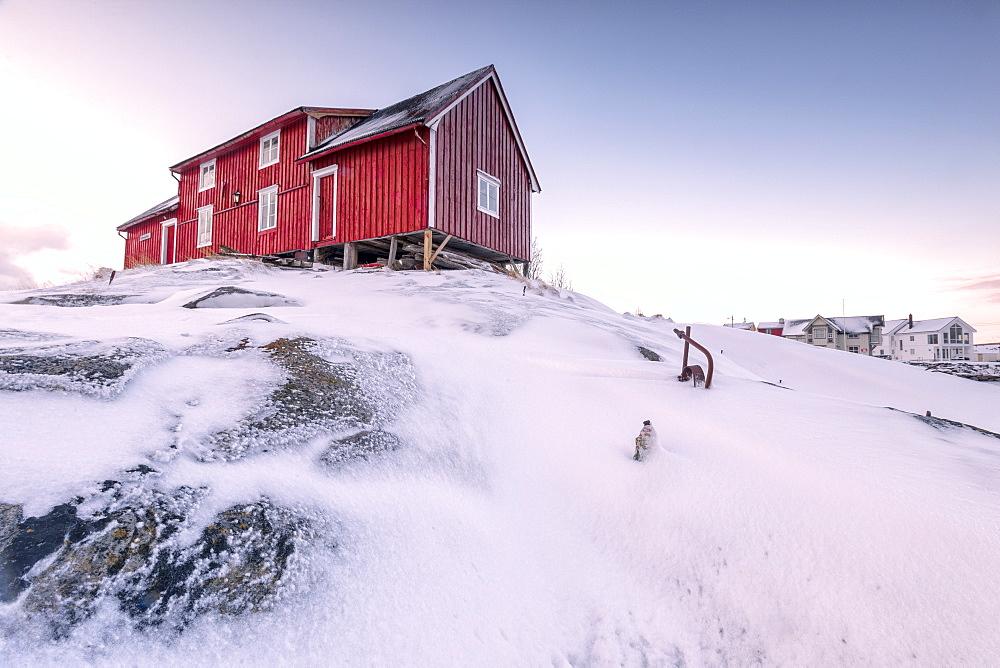 Pink sky on the typical red house of fishermen (rorbu), Henningsvaer, Lofoten Islands, Arctic, Northern Norway, Scandinavia, Europe
