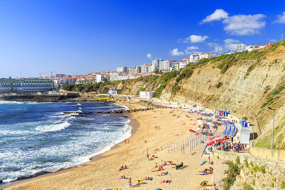 Top view of the village of Ericeira with the ocean waves crashing on the touristic sandy beach, Mafra, Portugal, Europe