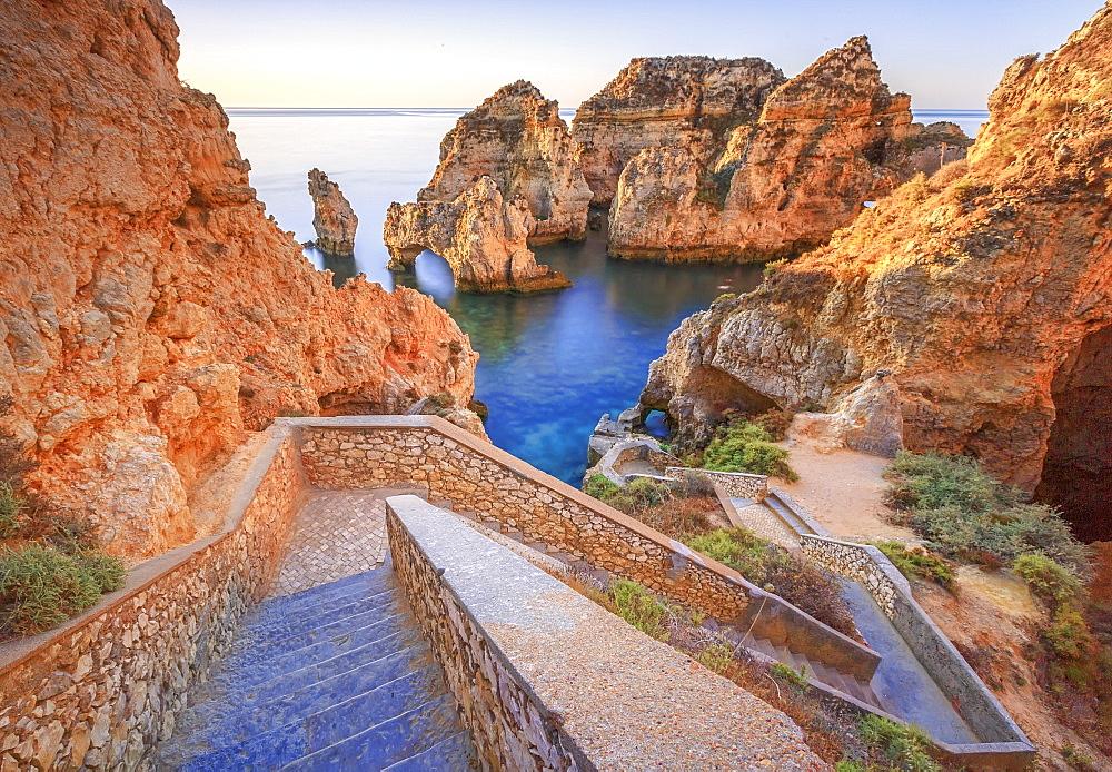Soft colors of dawn on the red cliffs of Ponta Da Piedade, Lagos, Algarve, Portugal, Europe