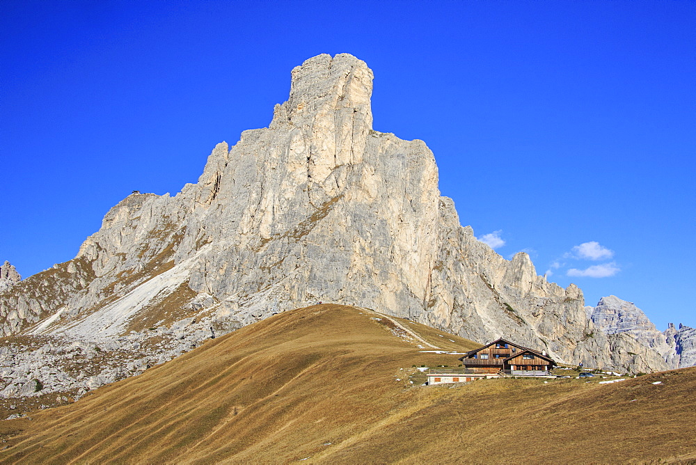 Autumnal view of the high rocky peak of Ra Gusela from Falzarego Pass, Dolomites of Belluno, Trentino-Alto Adige, Italy, Europe