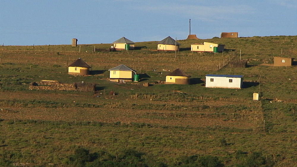 Huts and houses, rondavels in rural Lesotho highlands, Lesotho, Africa