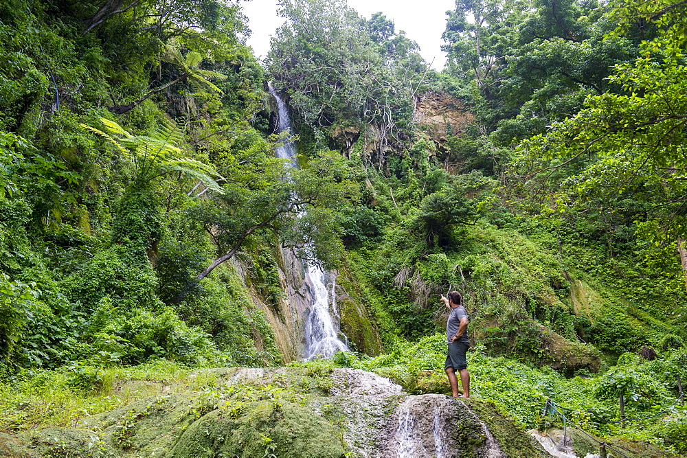 Man standing underneath the Mele Cascades, Efate, Vanuatu, Pacific