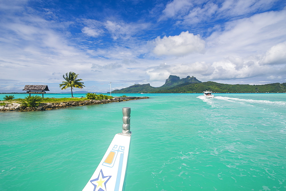 Little boat in the turquoise lagoon of Bora Bora, Society Islands, French Polynesia, Pacific