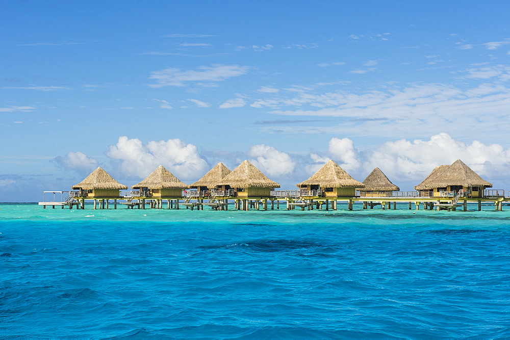Overwater bungalows in luxury hotel in Bora Bora, Society Islands, French Polynesia, Pacific