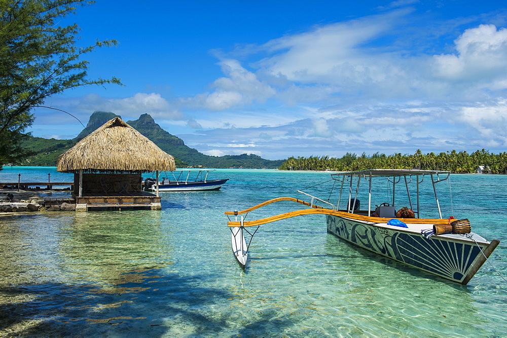 Little boat anchoring on a small Motu, Bora Bora, Society Islands, French Polynesia, Pacific