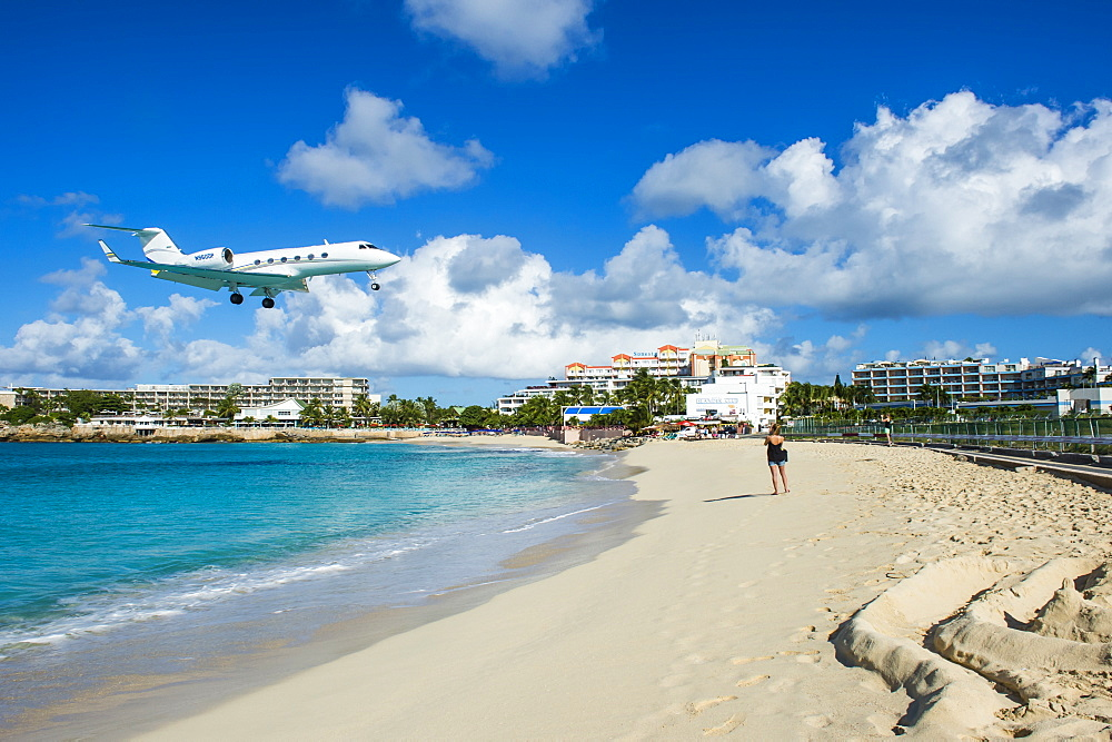 Airplane flying in the Princess Juliana International Airport of Maho Bay, Sint Maarten, West Indies, Caribbean, Central America