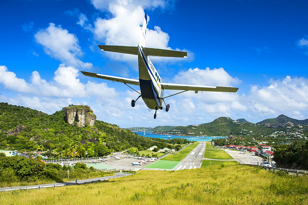 Small airplane landing at the airport of St. Barth (Saint Barthelemy), Lesser Antilles, West Indies, Caribbean, Central America