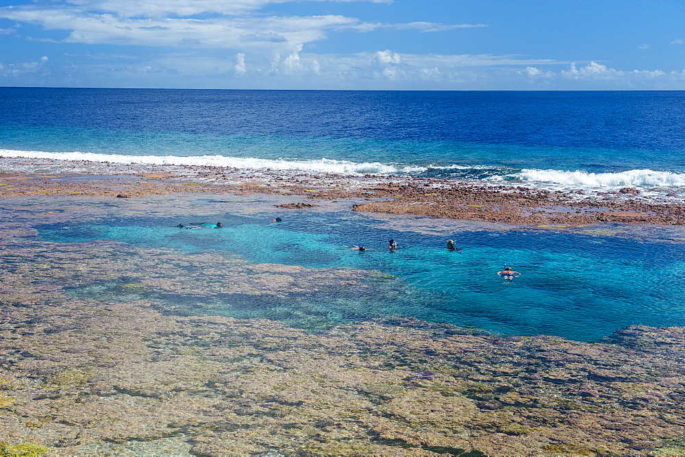 People swimming in the amazing Limu low tide pools, Niue, South Pacific, Pacific