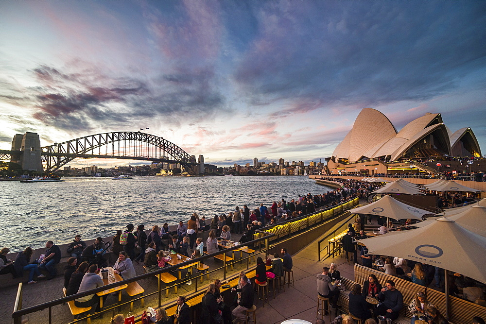 Sydney harbour with the harbour brisge and the opera after sunset, Sydney, New South Wales, Australia