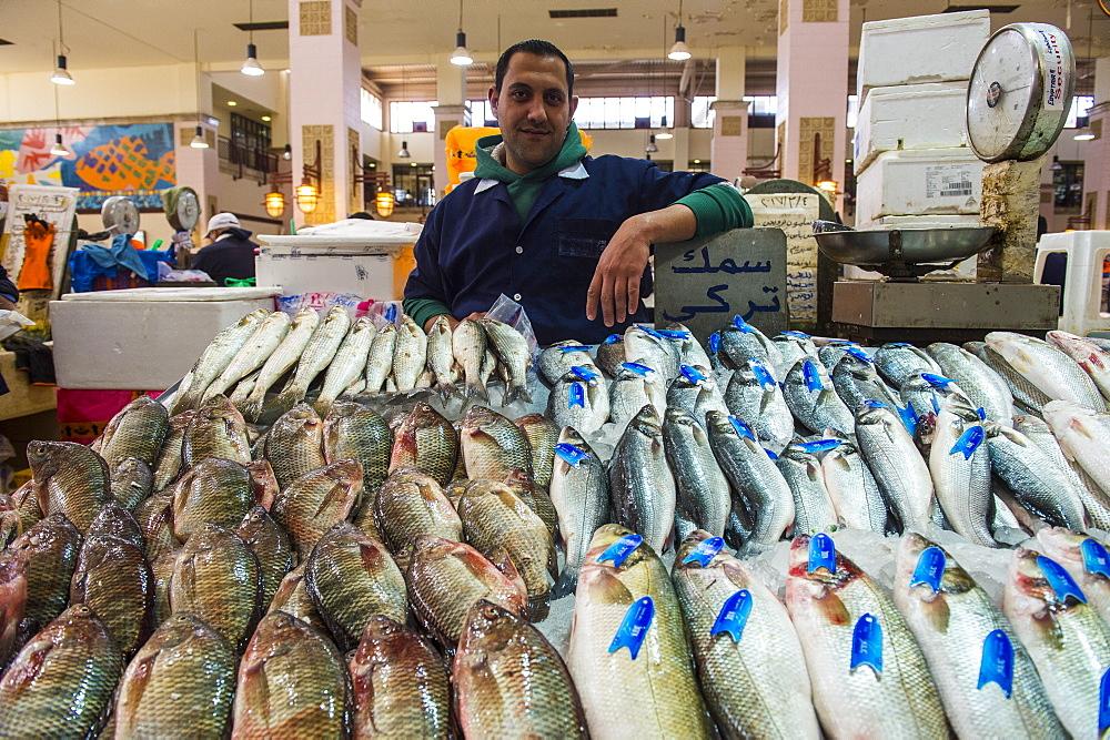 Local fisher man showing his fish, Fishing market, Kuwait City, Kuwait - 1184-1367