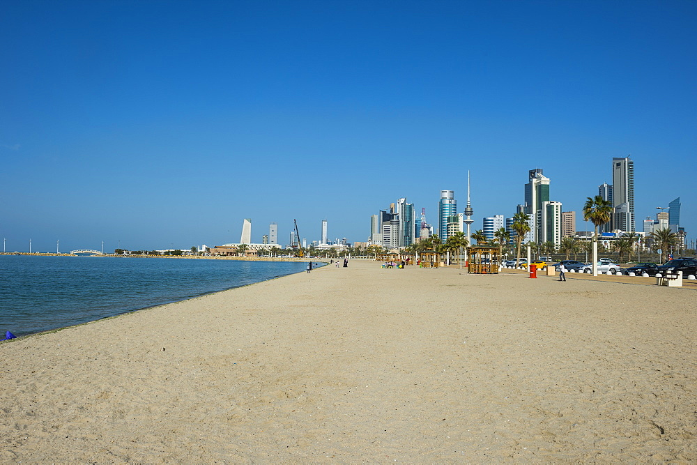 Shuwaikh beach before the skyline of Kuwait City, Kuwait