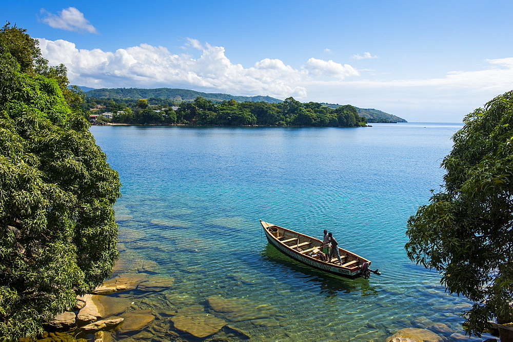 View over a canoe on Nkhata Bay, Lake Malawi, Malawi, Africa