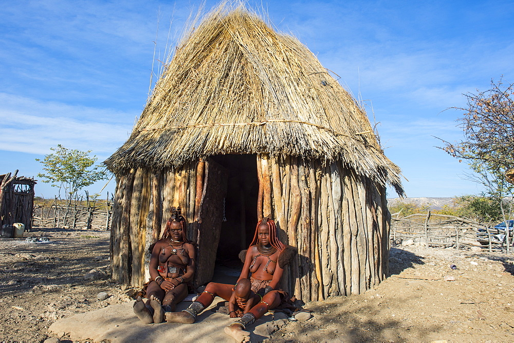 Himba women in front of their hut, Kaokoland, Namibia, Africa