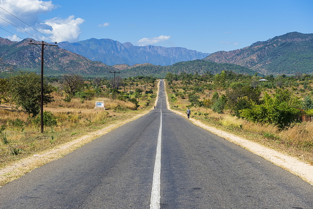 Long straight road in central Malawi, Africa