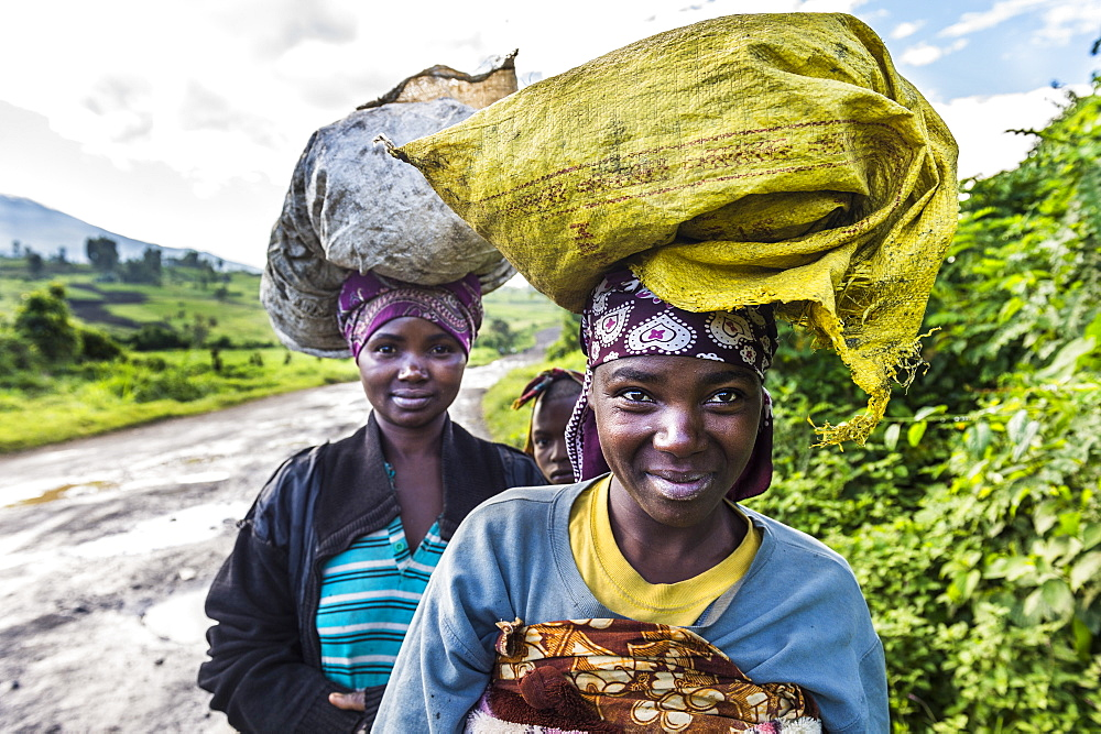 Local women carrying goods on their heads, Virunga National Park, Democratic Republic of the Congo, Africa