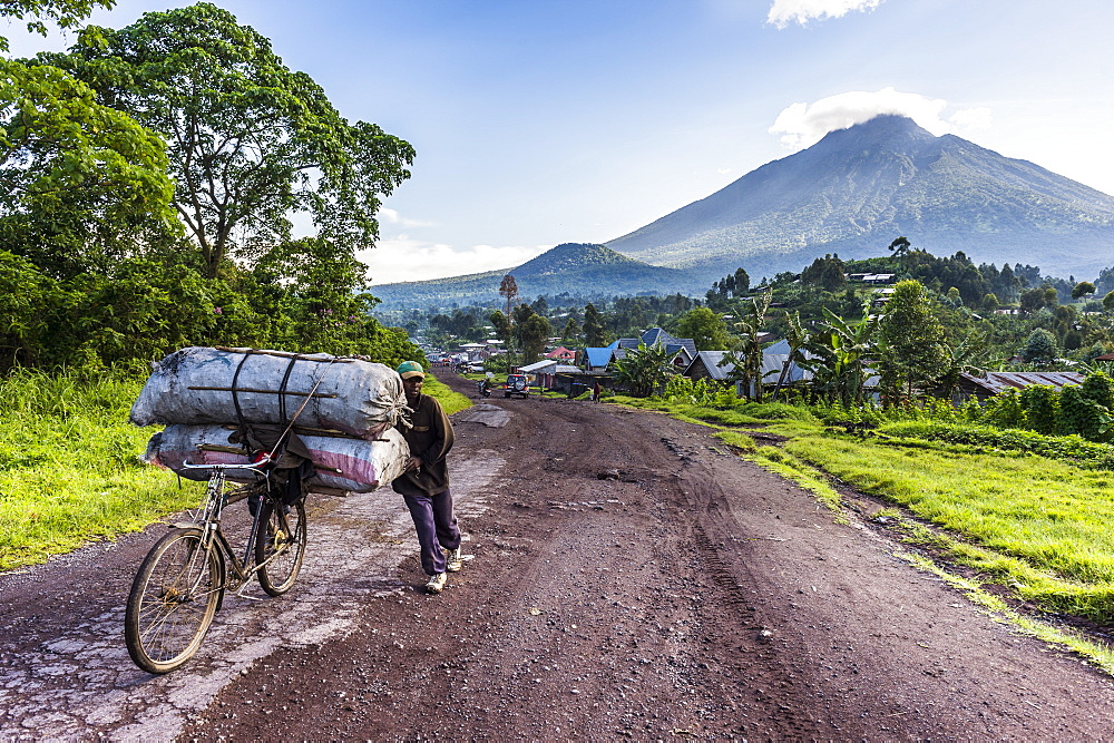 Man carrying a lot of bags on a bicycle, Virunga National Park, Democratic Republic of the Congo, Africa