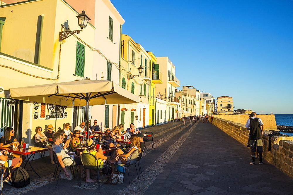 Restaurant on the ocean promenade in the coastal town of Alghero, Sardinia, Italy