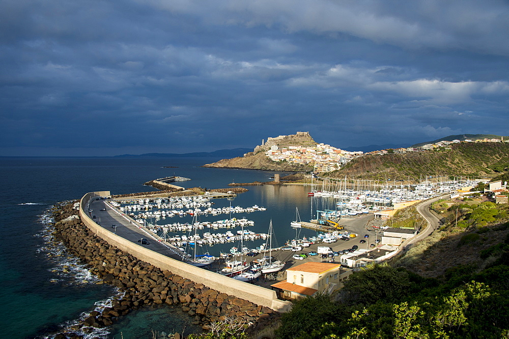 Dramatic light over the old town of Castelsardo with its boat harbour, Sardinia, Italy, Mediterranean, Europe