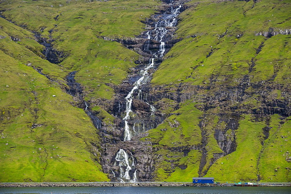 Waterfall tumbling down the hill, Streymoy, Faroe Islands, Denmark, Europe