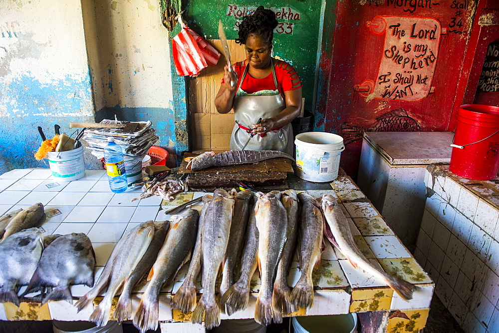 Woman preparing fresh fish in the Stabroek market, Georgetown, Guyana, South America