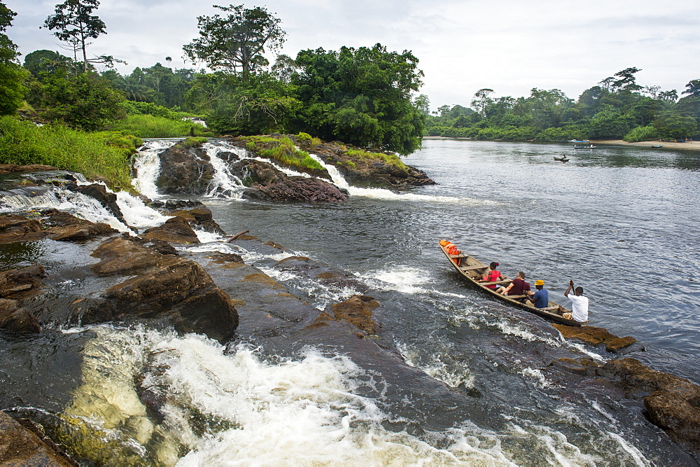 Tourist boat below the Lobe waterfalls, Kribi, Cameroon, Africa