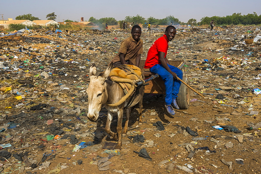 Friendly boys on a public rubbishdump, Niamey, Niger, Africa