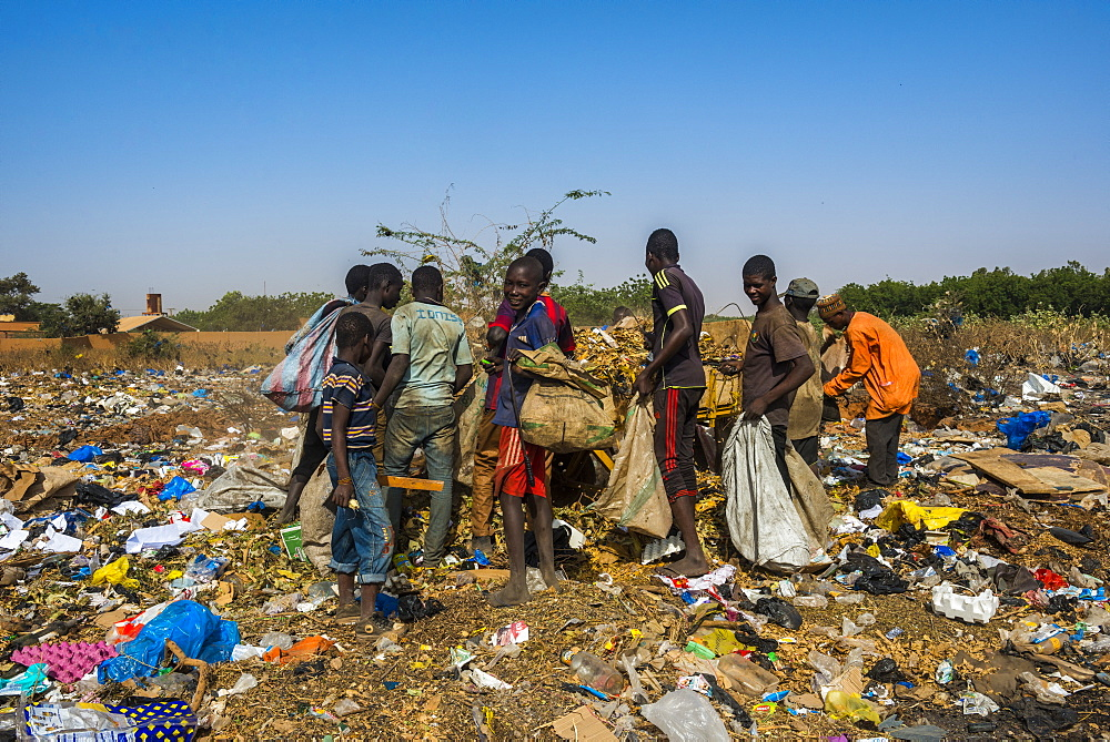 Local boys looking for valuables in the public rubbish dump, Niamey, Niger, Africa