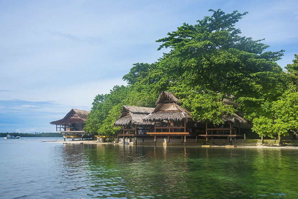 Traditionally built huts in the Nusa Island retreat, Kavieng, New Ireland, Papua New Guinea, Pacific