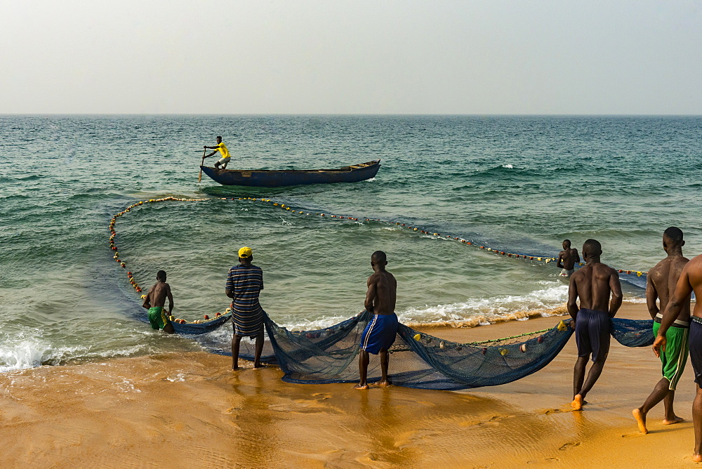 Local fishermen pulling their nets on a beach in Robertsport, Liberia - 1184-2264