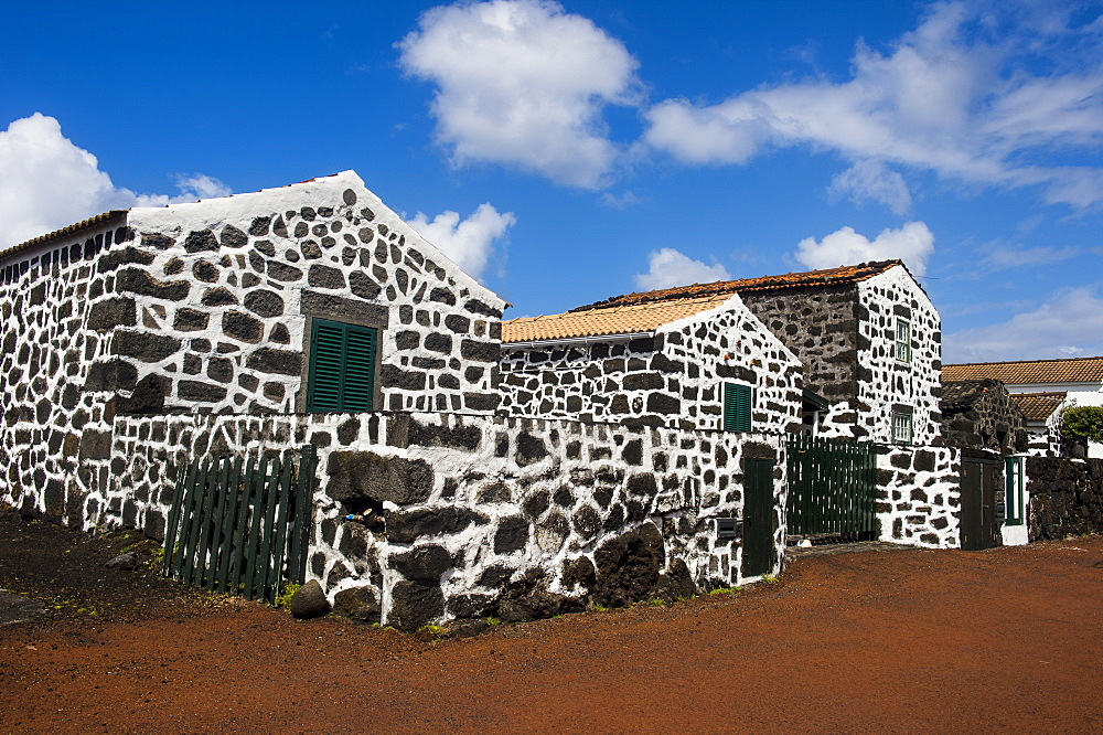 Painted lava stone houses in Lajido, Island of Pico, Azores, Portugal, Atlantic, Europe