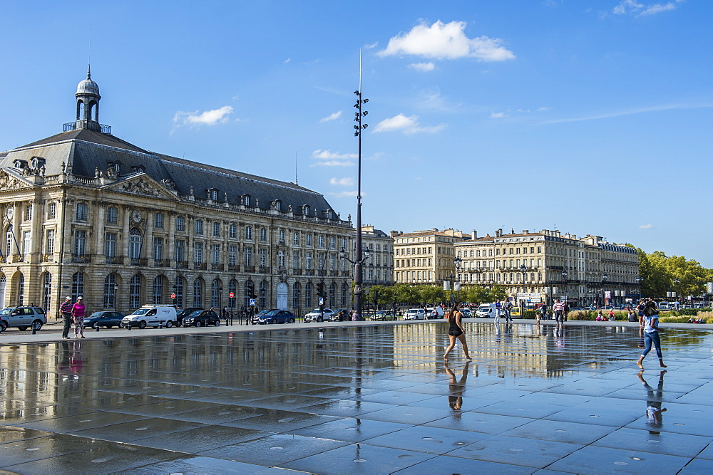 People standing in the water mirror on Place de la Bourse, Bordeaux, Aquiaine, France, Europe