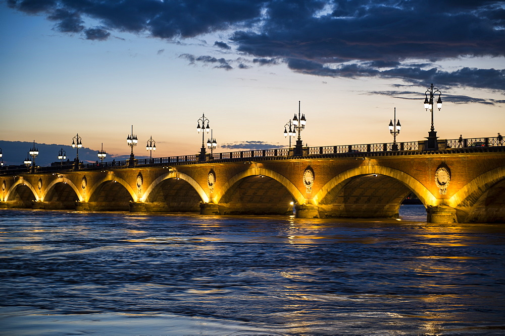 Historic bridge Pont de Pierre over the Garonne River at sunset, Bordeaux, Aquitaine, France, Europe