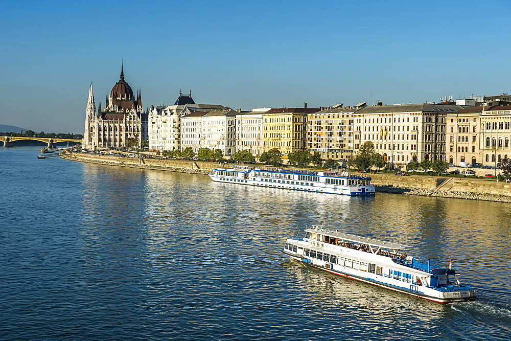Little ferries on the River Danube in front of the Panorama of Pest, Budapest, Hungary, Europe