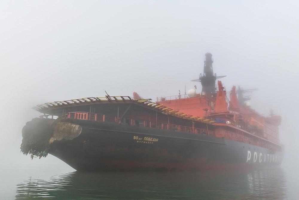 Icebreaker in the fog anchoring in Tikhaya bay on Hooker island, Franz Josef Land archipelago, Russia