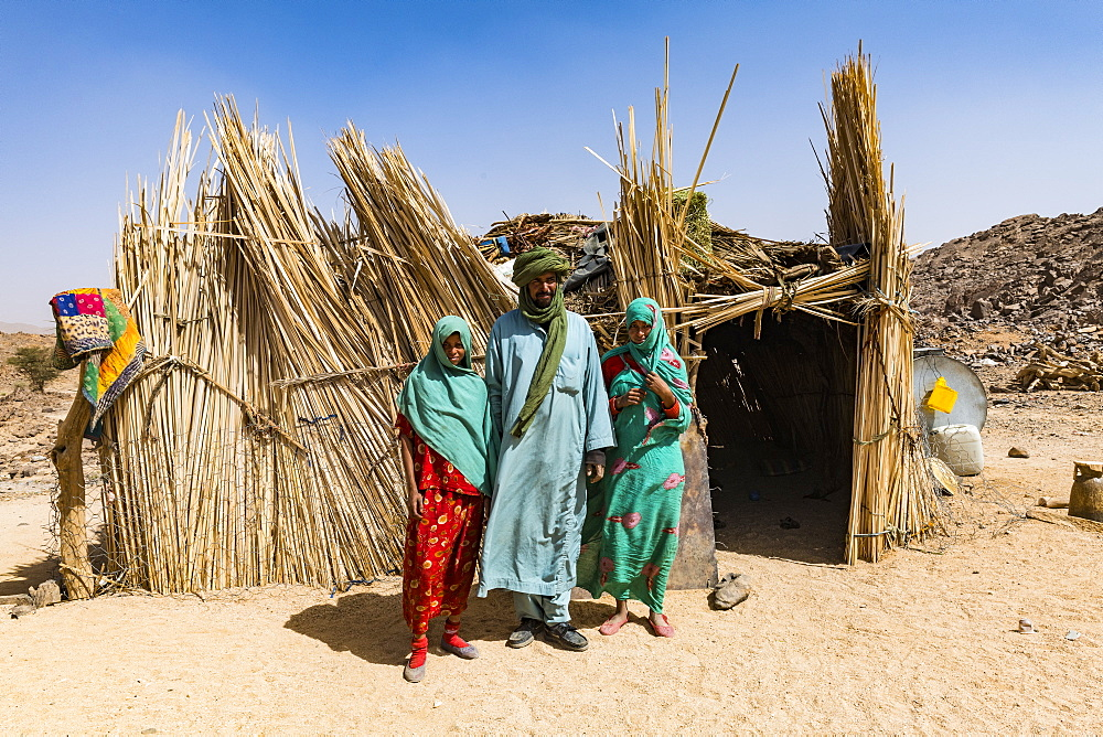 Tuareg family posing in front of their hut, near Tamanrasset, Algeria, North Africa, Africa