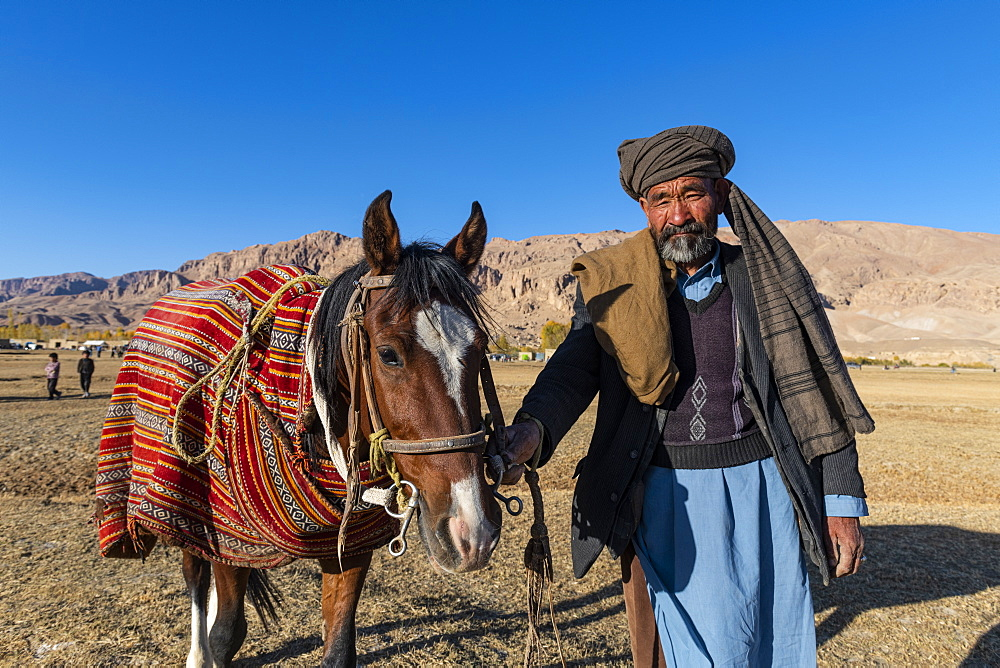Old man with his horse at a Buzkashi game, Yaklawang, Afghanistan