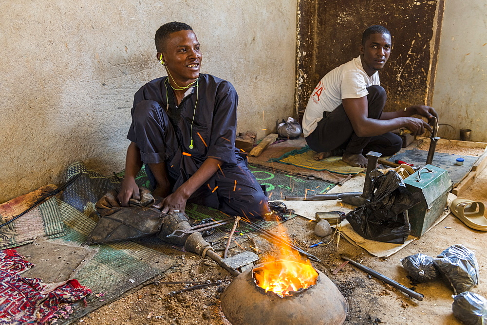 Man working on Jewllery in the UNESCO World Heritage Site, Agadez, Niger, West Africa, Africa