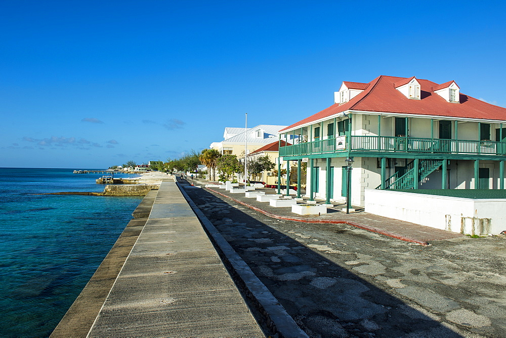 View of the beachfront with the colonial houses of Cockburn Town, Grand Turk, Turks and Caicos, Caribbean, Central America