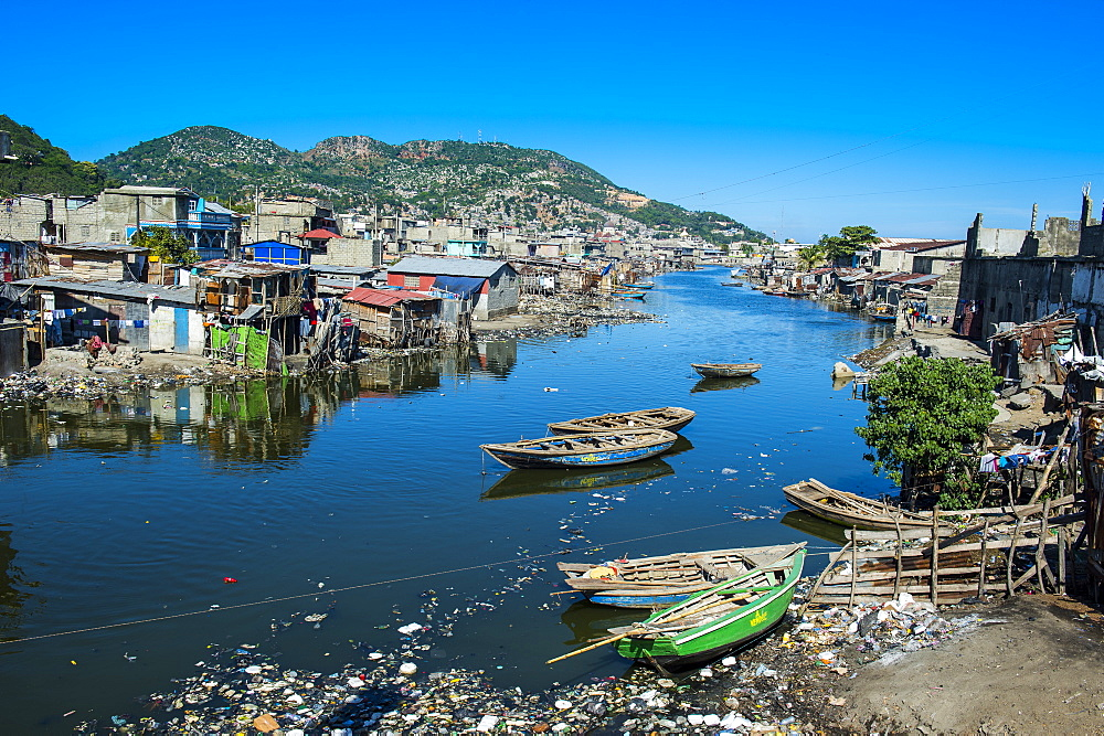 Totally polluted River Mapou flowing through Cap Haitien, Haiti, Caribbean, Central America