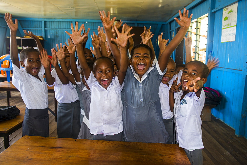 Very happy school children in a school, Yanuya island, Mamanuca islands, Fiji, South Pacific, Pacific