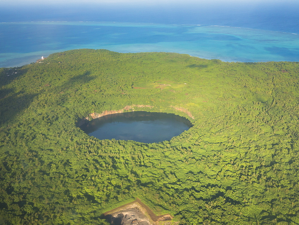 Aerial of Lalolalo lake volcanic crater lake, center of Wallis, Wallis and Futuna, South Pacific, Pacific