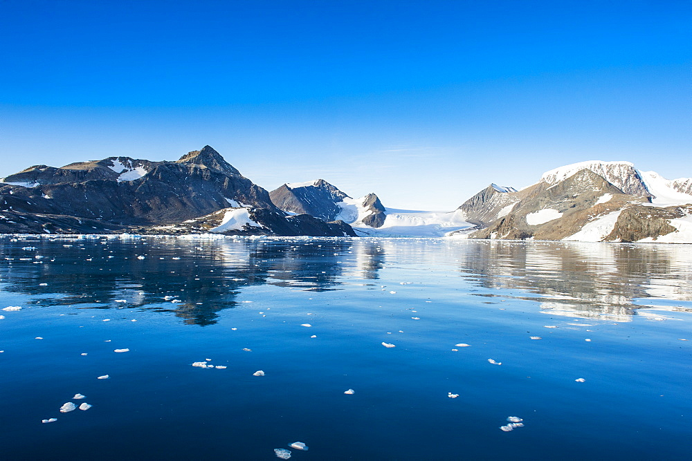 Mountains reflecting in glassy water of Hope Bay, Antarctica