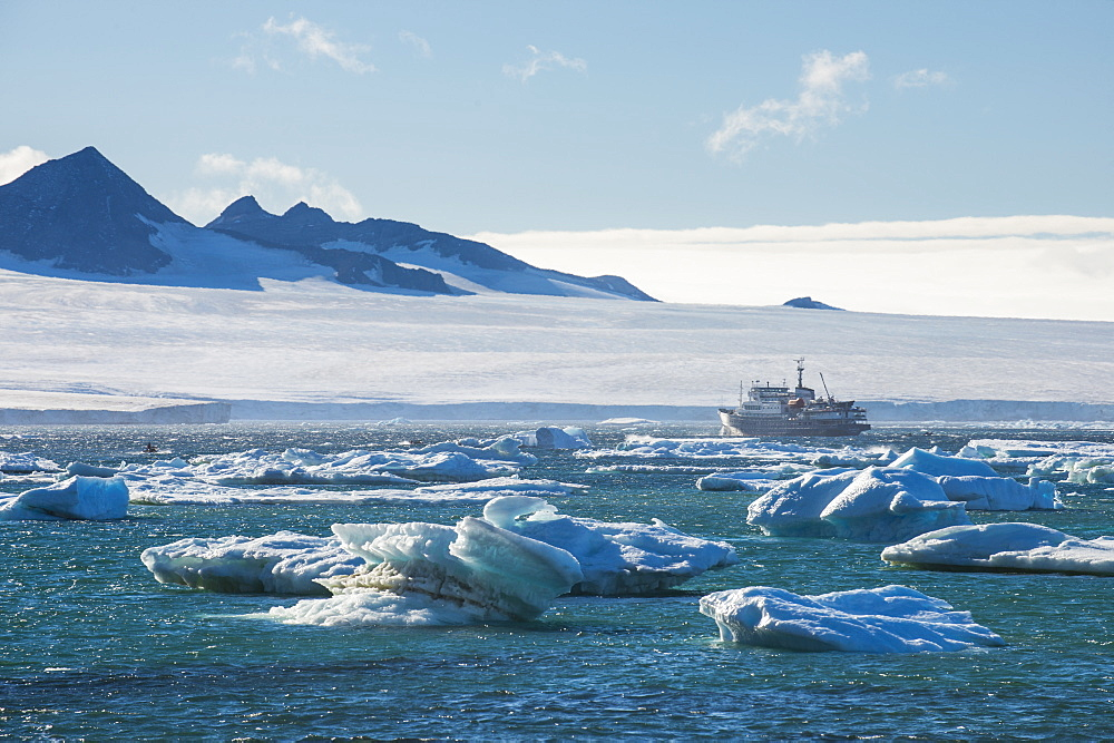 Cruise ship behind icebergs, Brown Bluff, Tabarin Peninsula, Antarctica, Polar Regions